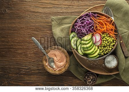 Healthy Vegetable Meal With Cooked Vegetables On Wooden Table