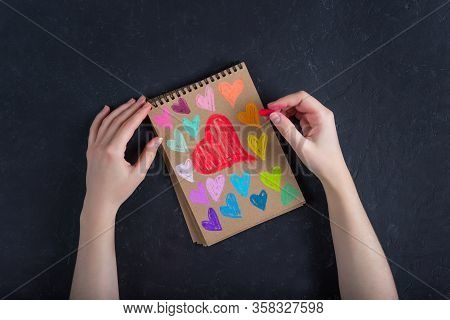 Valentines Day Card.colorful Hearts On Kraft Paper In A Notebook Painted With Chalk, Pastel On A Dar