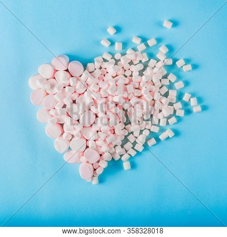 Heart Of Marshmallow On A Blue Background.valentine Day Background