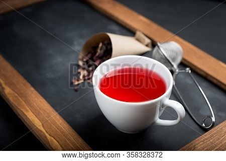 Red Tea In White Cup.dry Tea Leaves, White Background.the View From The Top.