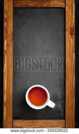 Freshly Brewed Red Tea In Cup .dark Background.top View, Space For Text