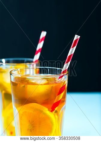 Cold Iced Tea With Lemon In A Transparent Glass