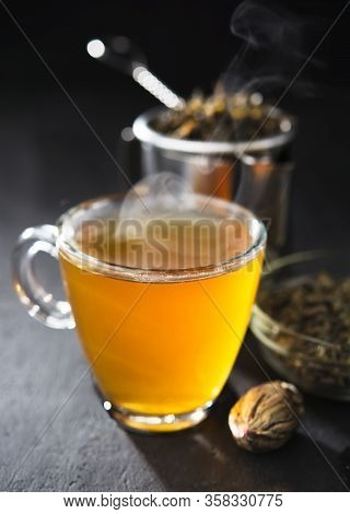 Process Brewing Tea, Tea Ceremony, Cup Of Freshly Brewed Yellow Or Green Herb Tea, Warm Soft Light,