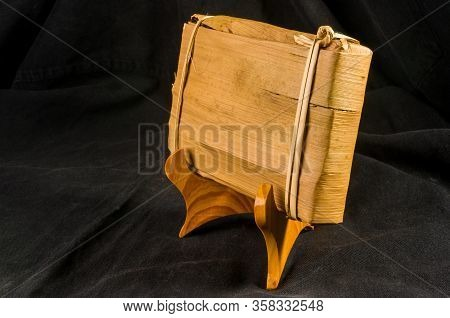 Chinese Pressed Pu-erh Tea In Bamboo Leaf Packaging, Close-up, Macro