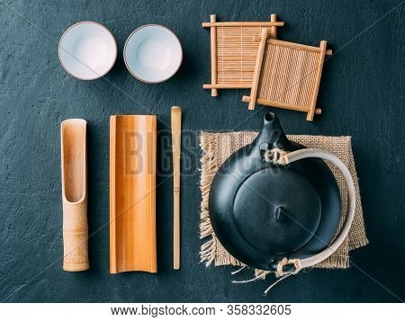 Tea Table Accessories Wooden Spoon And In A Glass Jar On A Dark Background.