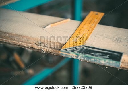 Length Measurement Using A Metal Ruler-corner On A Wooden Board, Carpentry