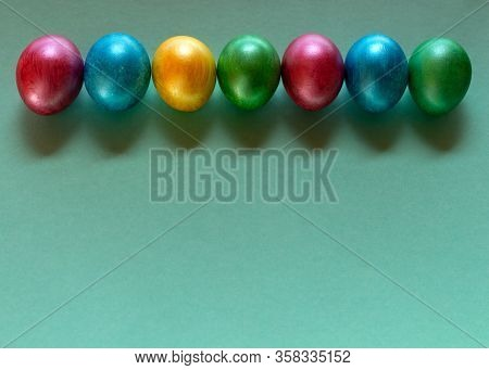 Colorful Easter Eggs On Mint Color Background. Happy Easter Composition. Copy Space.