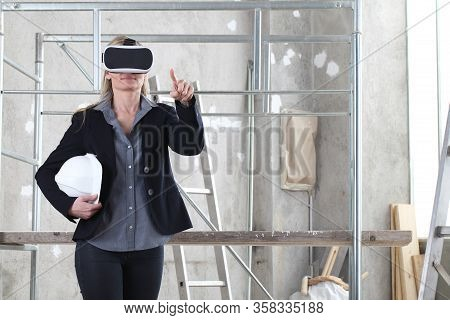 Woman Architect Or Construction Engineer Wear Virtual Reality Glasses And Helmet And Touch Screen In