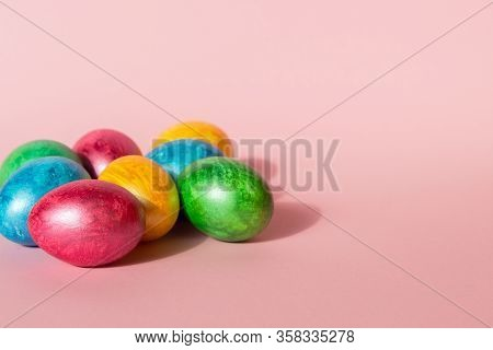 Colorful Easter Eggs On Pink Background. Happy Easter Composition. Copy Space.