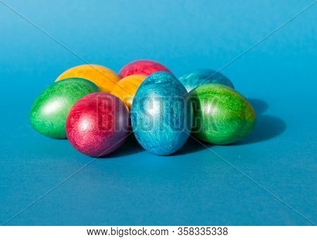Colorful Easter Eggs On Blue Background. Happy Easter Composition. Copy Space.