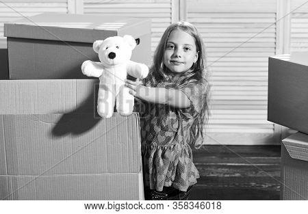 Only True Friend. Girl Child Play With Toy Near Boxes. Move Out Concept. Prepare For Moving. Moving