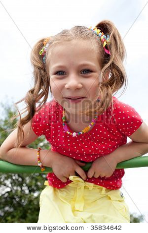 Smiling Girl Plays On The Playground