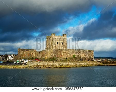 Medieval Norman Castle In Carrickfergus Near Belfast, Northern Ireland, With Marina In Winter. Drama