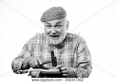 Man Bearded Handyman Working With Tools White Background. Shoe Repair Shop. Senior Master With Hamme
