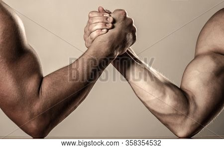 Muscular Men Measuring Forces, Arms. Hand Wrestling, Compete. Hands Or Arms Of Man. Muscular Hand. R
