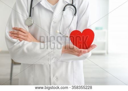 Cardiologist With Red Heart In Ca Linic