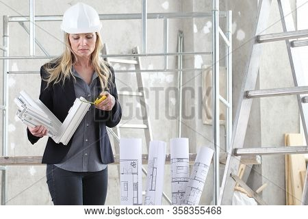 Woman Architect Or Construction Interior Designer With With Meter Measuring White Windows Cutaway Pr