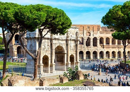 Rome, Italy - October, 2019: The Colosseum And Arch Of Constantine In Rome, Italy During Summer Sunn