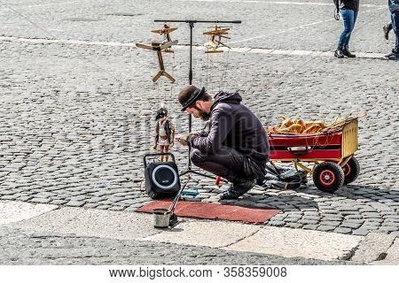 Naples 2017 March 19, Italy: Puppets At Piazza Del Plebiscito In Naples, And Puppeteers Prepares His