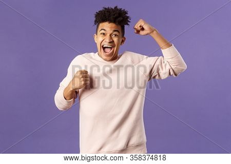 Portrait Of Excited Happy Man Seeing His Team Scored Goal On Sports Tv Channel, Chanting Raise One H