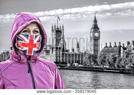 Woman Wearing Protection Face Mask With British Flag Against Coronavirus In Front The Of Big Ben, Lo