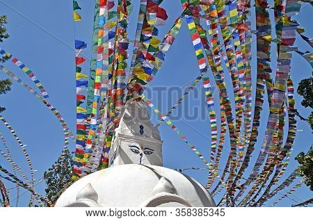 One Of The Stupas (prayer Hall) With Its Traditional Decoration: Colorful Flags With Prayers. Kathma