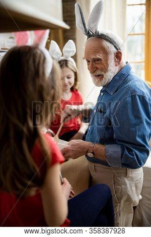 Mirthful Grandpa Spending Time With Grandchildren Stock Photo