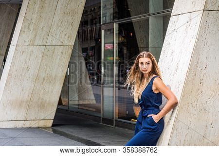 Street Fashion In New York City. Young Eastern European American Woman With Long Brown Hair, Wearing