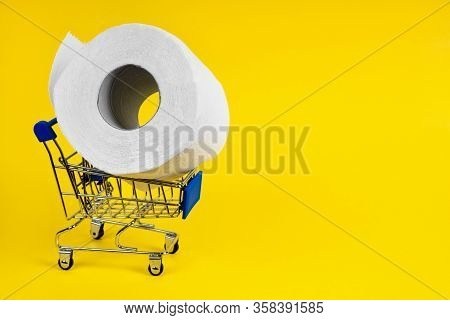 There Is No Toilet Paper. Shopping Cart For Products With Toilet Paper On A Yellow Background. Conce