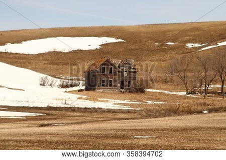 An Abandoned Farm House During Early Spring. Picture Was Taken In The Sheyenne Valley In Eastern Nor