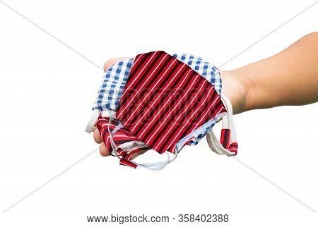 Mask Fabric Prophylaxis Virus Striped Homemade Pile In Hand Over White Background. Prevent Coronavir