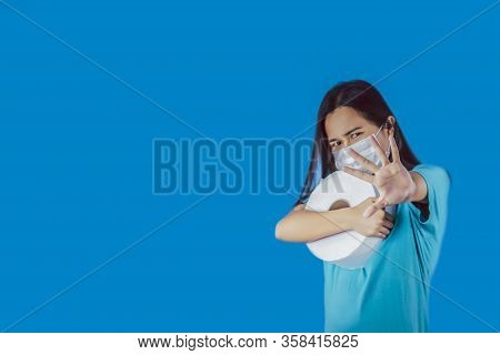 Asian Woman Show Stop Hands Gesture For Stop Usurp Tissue Peper And Wearing Mask For Virus On Blue B