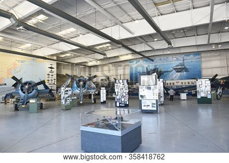 PALM SPRINGS, CA - MARCH 24, 2017: Palm Springs Air Museum. Hangar exhibits with vintage plane at the Palm Springs Air Museum.