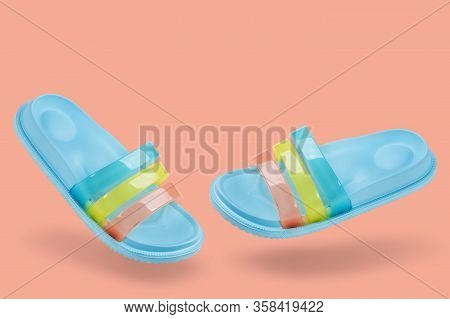 Concept Of Summer And Vacation, Blue Pastel Rubber Slippers For The Shower Or For The Beach, Levitat