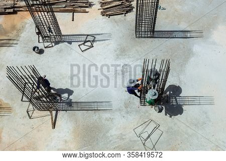 Working On Construction Site Steel Frame,construction Workers Fabricating Floor Slab Reinforcement B
