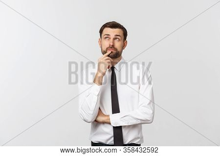 Thinking Man Isolated On White Background. Closeup Portrait Of A Casual Young Pensive Businessman Lo