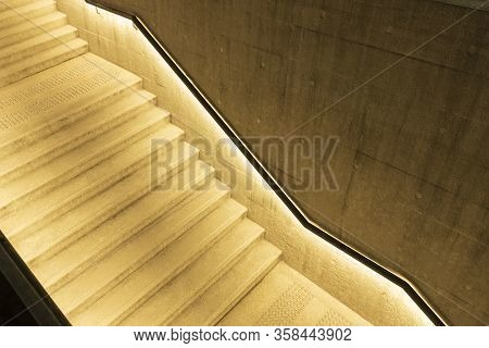 Empty Stairway With Illuminated Bannister In Modern Architecture