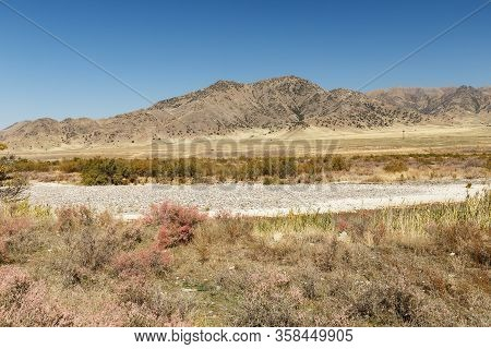 State Border Between Kazakhstan And Kyrgyzstan, Chuy Valley. View Of Kazakhstan From Kyrgyzstan