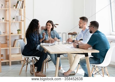 Diverse Colleagues Discuss Business Ideas At Briefing