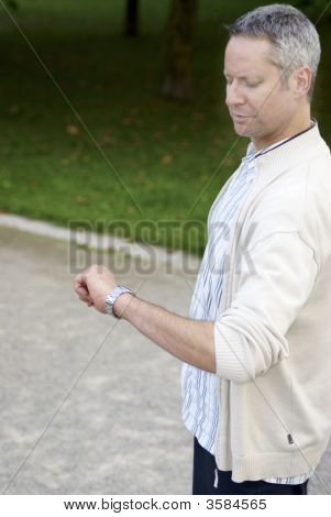 Young Man Lookng At Watch