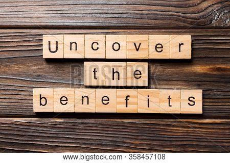 Uncover The Benefits Word Written On Wood Block. Uncover The Benefits Text On Table, Concept