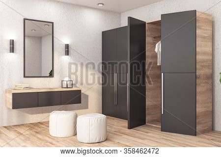 Modern Wardrobe With Clothes In Stylish Bedroom Interior Wooden Floor And Mirror On Wall. 3d Renderi