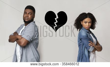 Breakup And Divorce Concept. Collage Of Unhappy Black Couple Standing Back To Back With Ripped Heart