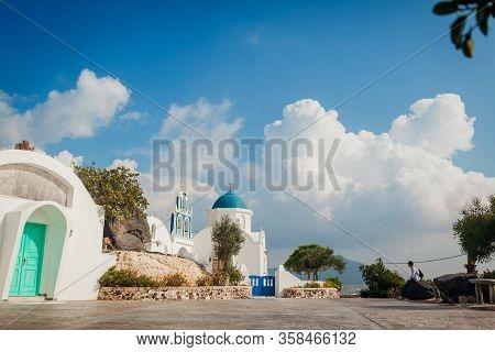 Santorini Traveler Exploring Discovering Greek Church Architecture In Akrotiri. Man Hiker Having Res