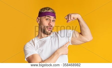 Sports Results Concept. Funny Man Shows Biceps, Free Space