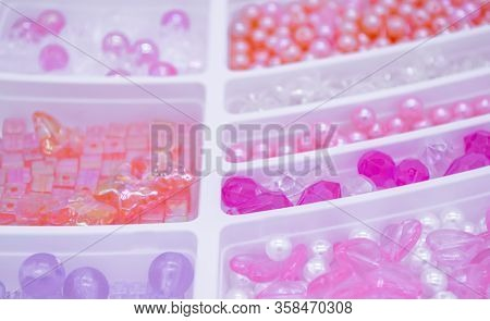 Close Up Of A Variety Of Pearls And Beads Pink, Orange, White, Violete  Colors And Transparent For C