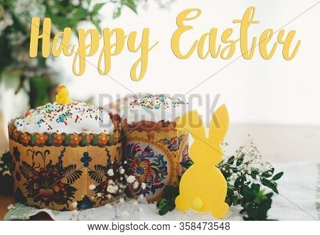 Happy Easter Text. Easter Greetings Lettering. Homemade Easter Cake, Bunny Decor, Green Branches And