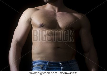 Strong Bodybuilder With Six Pack, Perfect Abs, Shoulders, Biceps, Triceps And Chest, Deltoid Muscle.