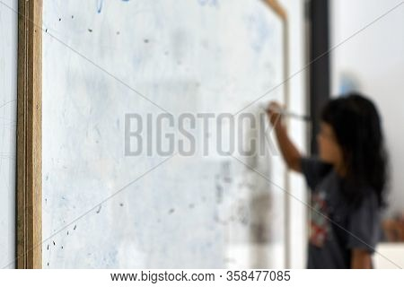 Learning From Home Practical : Asian Girl Writing On A White Board At Home