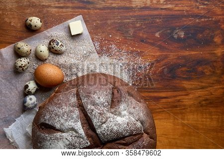 Fresh Round Homemade Rye Bread Wrapped In Baking Paper And Cotton Gauze, Colored Chicken And Quail E